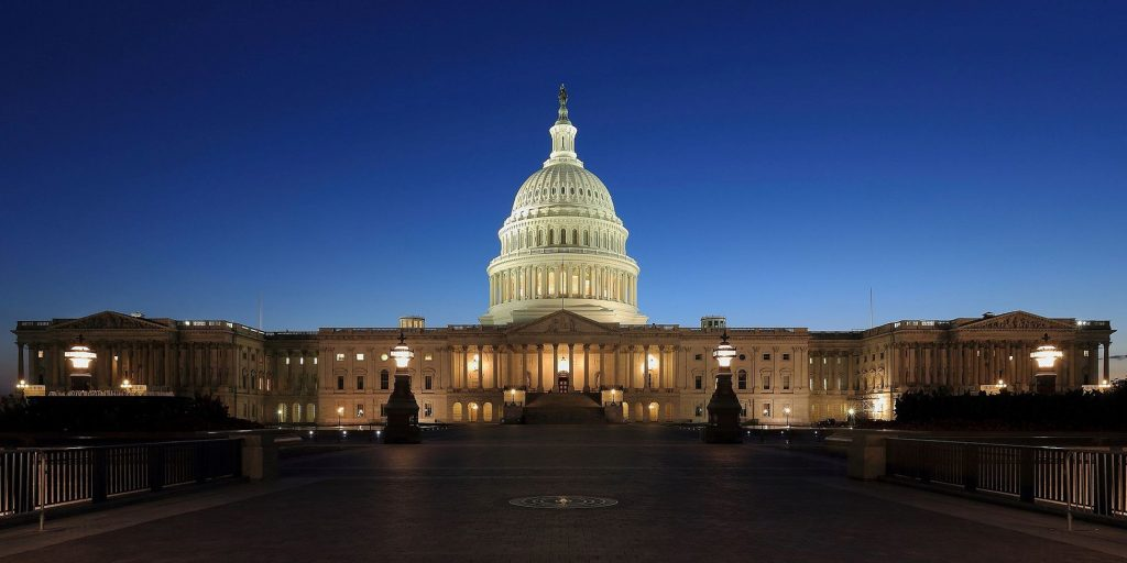 An image of the U.S. Capitol Building in the evening.
